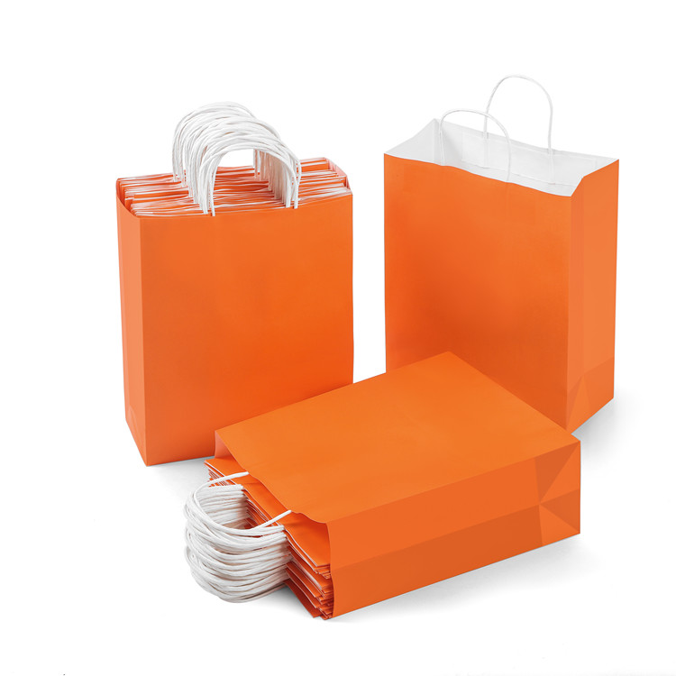Kraft orange pritning gift paper bag with twisted paper handle wholesale