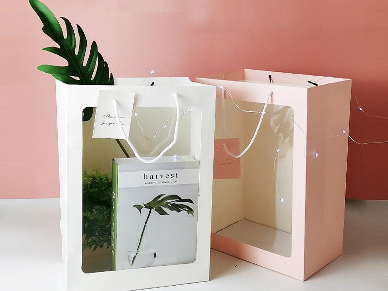 حقيبة ورقة هدية زهرة جميلة