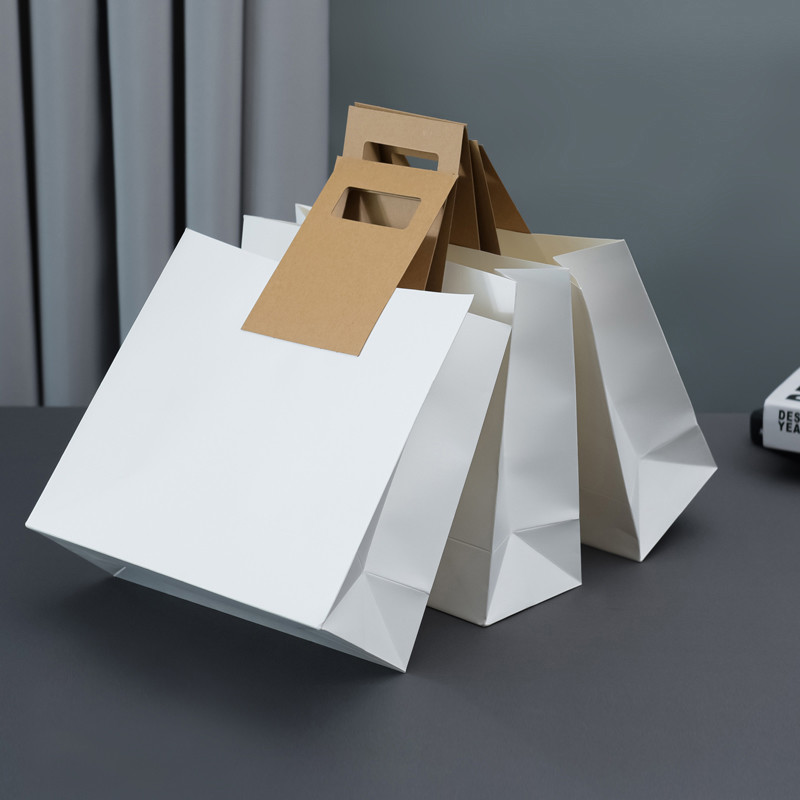 Hot Selling Creative Design White Kraft Paper Bag With Die-Cutting Handle