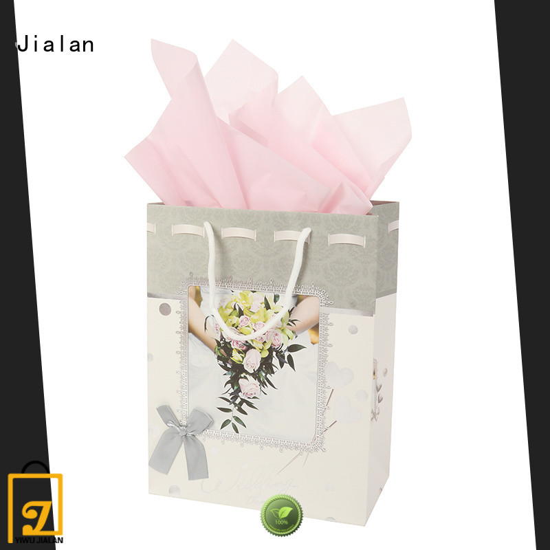 various personalized paper bags packing birthday gifts